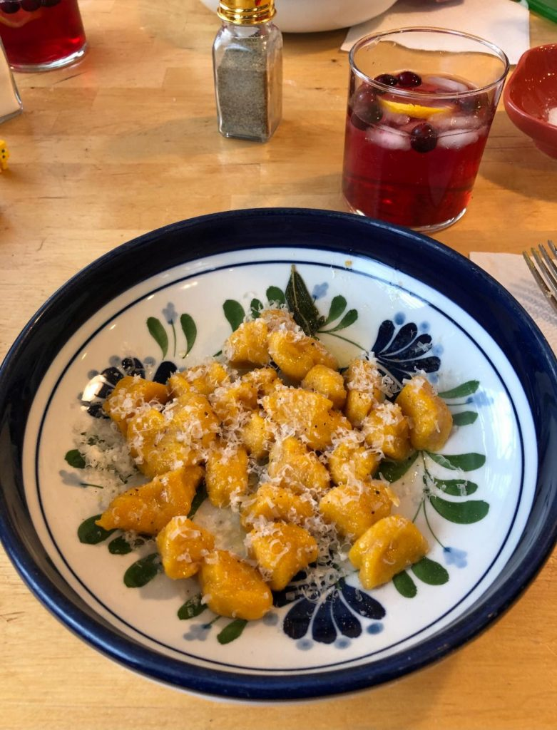homemade pumpkin gnocchi with sage, butter, and parmesan along with a cranberry lemon spritzer
